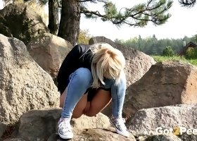 Cute lean blonde hottie on the rocky country side peeing
