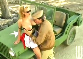 Big tits pinup babe Stormy Daniels fucks a horny soldier outdoors