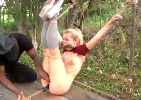 White blonde young chick bound outdoors and leftto drool