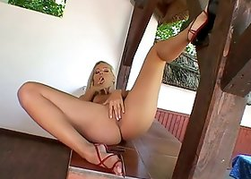 Horny blondie is enjoying anal self penetration