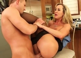 Blonde cougar works a massive pole
