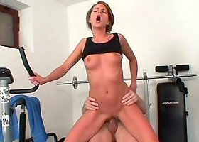 After some cardio she mounts up on her trainer and rides his cock