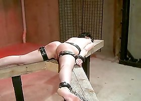 Tied up brunette gets brutally spanked and eaten out