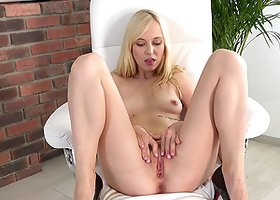 Blonde opens her cunt with fingers and a speculum